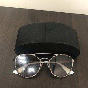 Authentic Prada sunglasses. With case